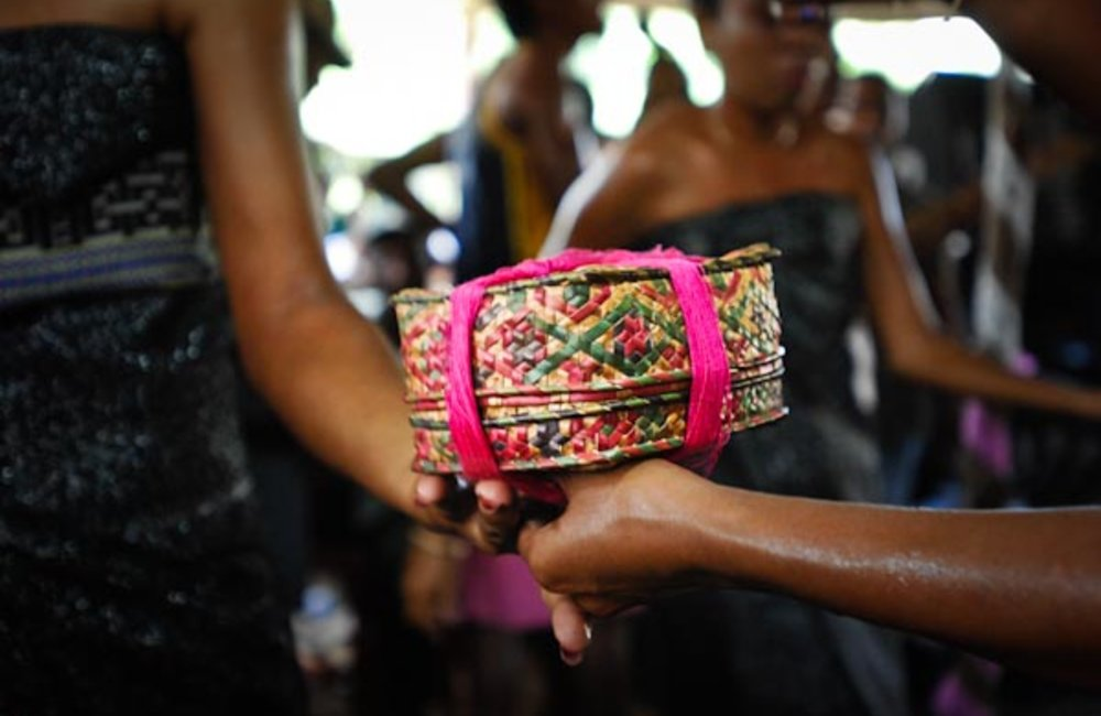 During a traditional engagement ceremony, a Luhu is past to the bride-to-be. Photo by UNMIT/Bernardi