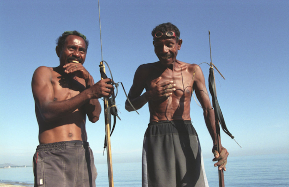 Two fishermen laughing in Dili. Photo UNMIT/Martine Perret