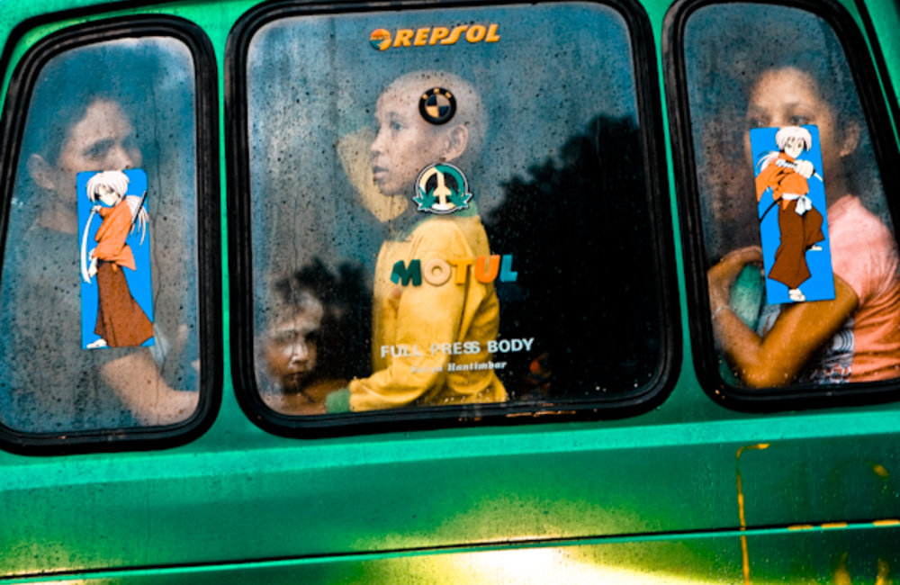 Passengers from a local Mikrolet in Dili watch the rain. Photo by UNMIT/Martine Perret