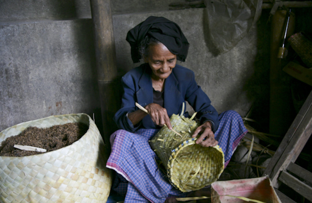 A woman from Ainaro weaves baskets. Photo by UNMIT/Martine Perret