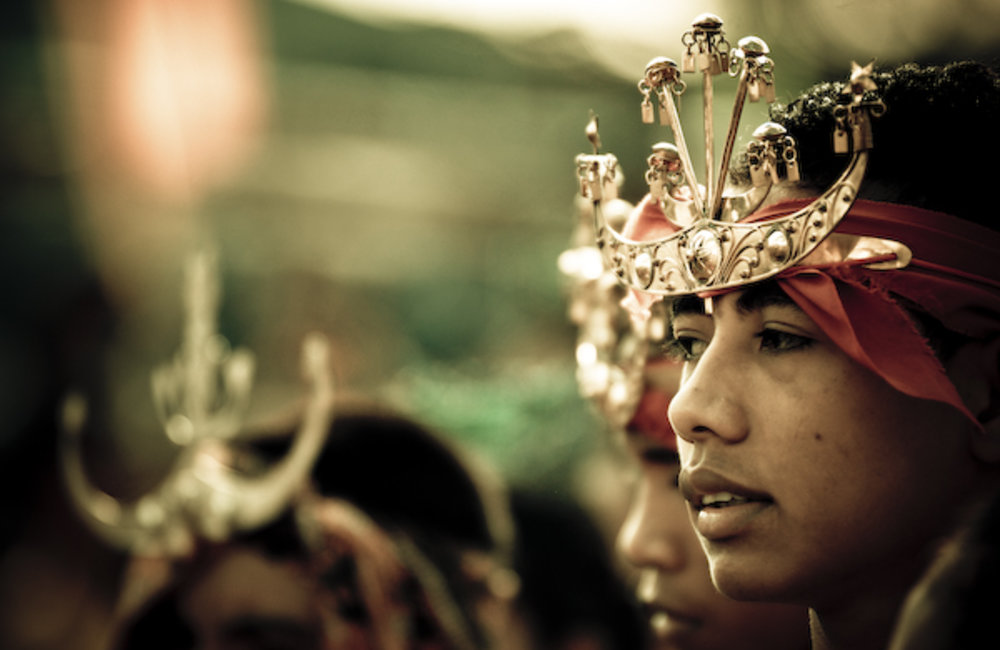 A young man from Viqueque wears a traditional crown. Photo by UNMIT/Bernardino Soares