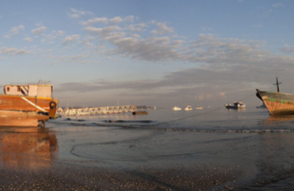 Sunrise at Dili harbour. Panoramic-stiched photo by UNMIT/Martine Perret