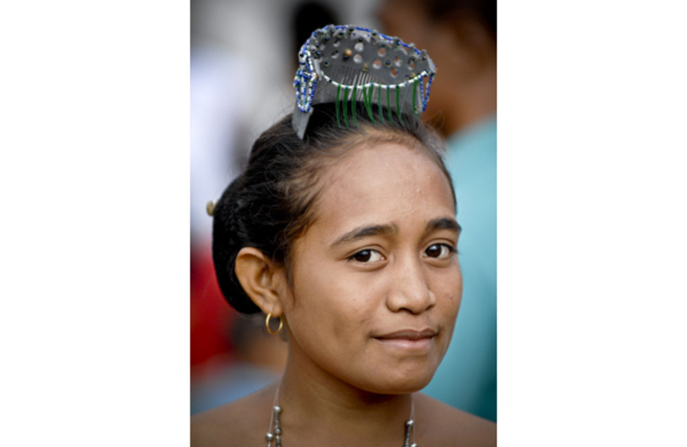 A young woman from Viqueque wears a traditional crown, ''Ulu-Suku''. Photo by Bernardino Soares/UNMI