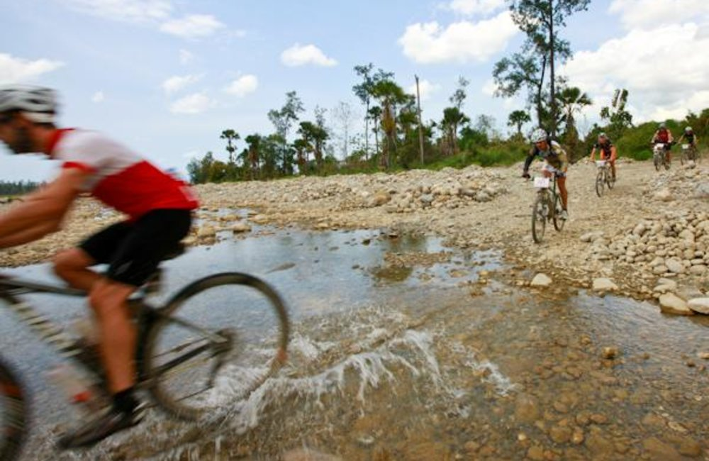 Tour de Timor riders cross a river bed near Beacu. UNMIT Photo/Martine Perret