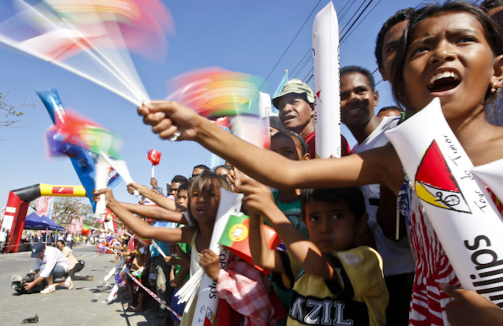 Crowds of people lined the road to the Presidential Palace to cheer on the arrival of Tour de Timor