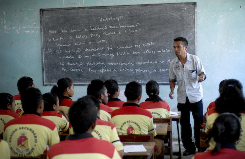 Jose Araújo, a teacher at Nicolau Lobato Secondary School, teaches Portuguese to 70 students in a c