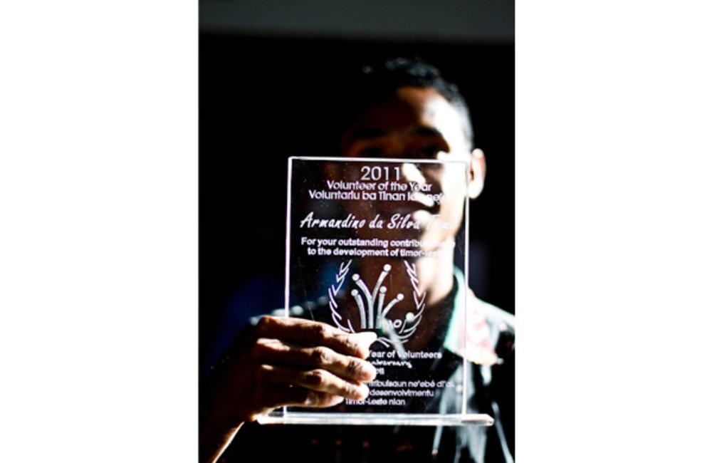 Armandino da Silva, from Cruz Vermelha de Timor-Leste, wins the award for volunteer of the year at t