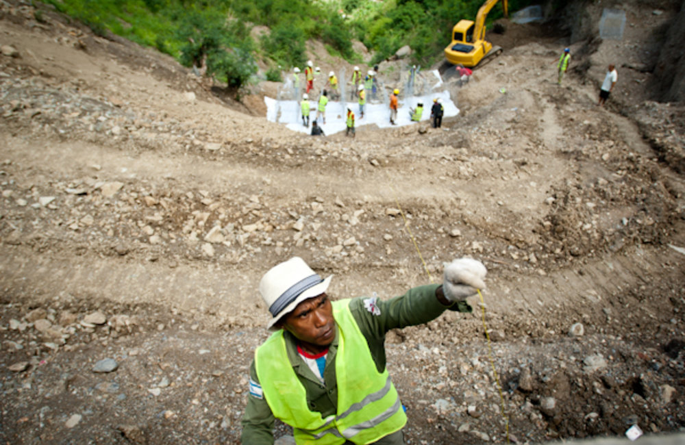 A workman involved with constructing roads and waterways in the area of Fatu Ahi, Dili district. Pho