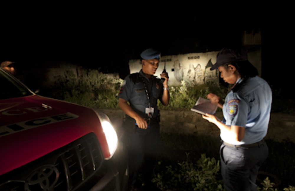 UN and national police officers (PNTL) conducting their nightly foot and car patrol through Dili. Ph