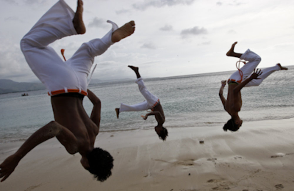 Members of the Movimento Adolesente Criancas practising Capoeira, an Afro-Brazilian art form that co