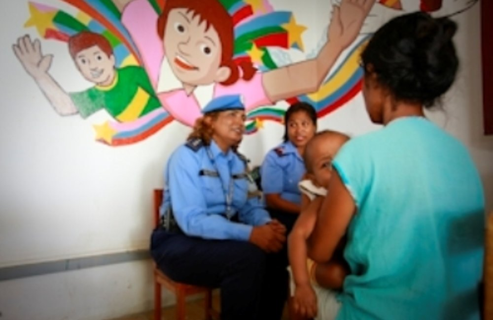 UN Police officer and Timorese Police officer conducting an interview with a victim of domestic viol