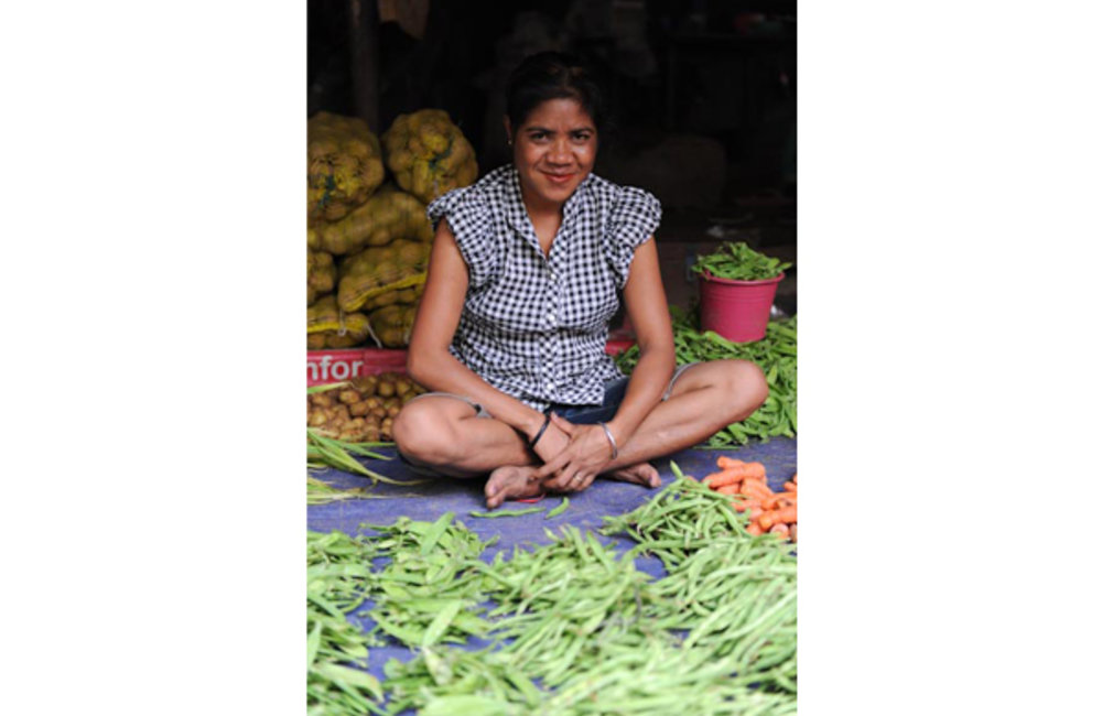 A seller of vegetables from the Hale-Laran Market. Photo by UNMIT/Bernardino Soares