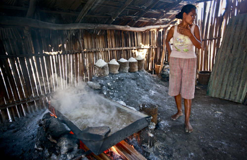 Florentina from Ulmera, near Tibar, cooks salt which she harvests from the sea. She sells the salt i