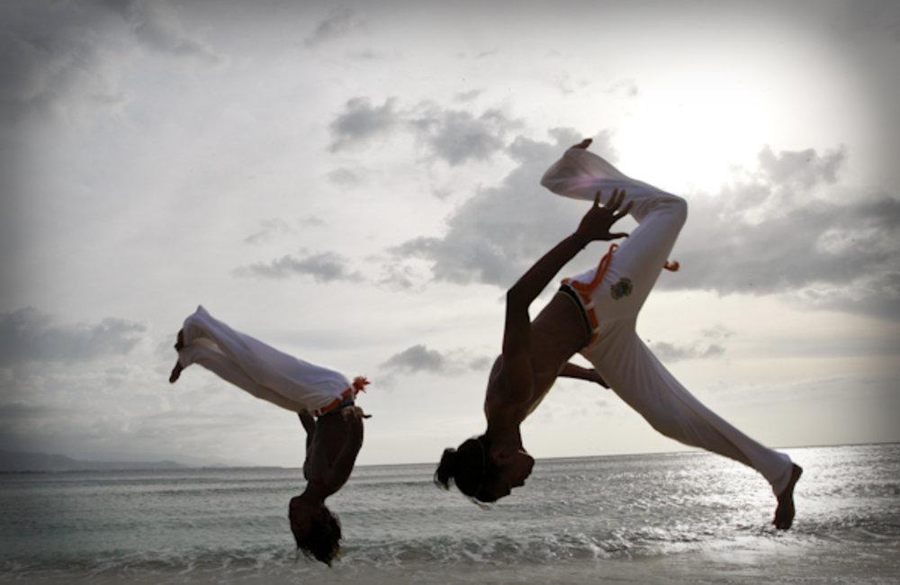 Young members of Movimento Adolescentes e Crianças (MAC) practice capoeira on the beach in Dili. Ph