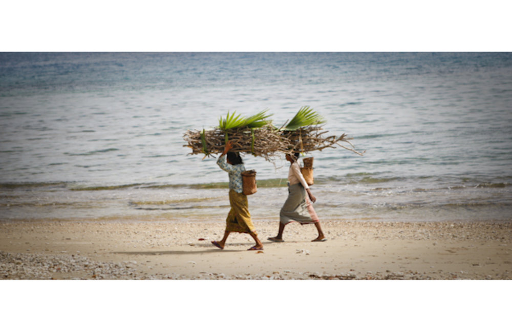 Women from Eukesi near Lautem carry wood home. Photo by UNMIT/Martine Perret