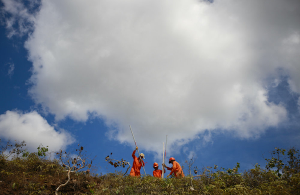 Workers prepare land for an electricty project between Aileu and Gleno. Photo UNMIT/Martine Perret