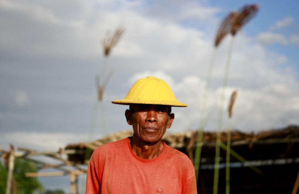 Portrait of a farmer standing in his field in Manatuto. Photo UNMIT/Martine Perret