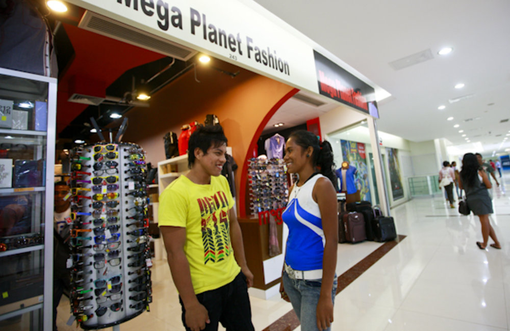 Ely and Herman work at new retail shops in the Timor Plaza shopping center in Dili. Photo by UNMIT/M