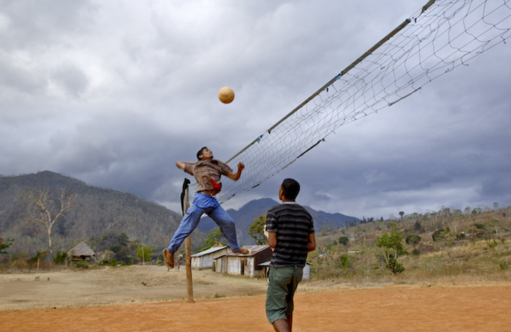 Youth from Lesuata, Sub District of Turiscai, play volleyball in the local pitch as part of their ev