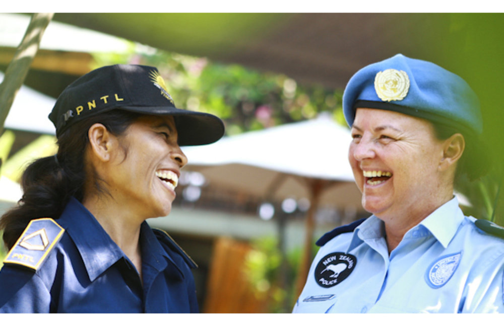 Portrait of Dili District Community Police officers, Sergeant Cesarina and Helen Dickson. Photo by U