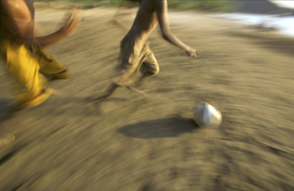 Timorese youth love sports, particularly football. Despite the late hours, many gathered in front of