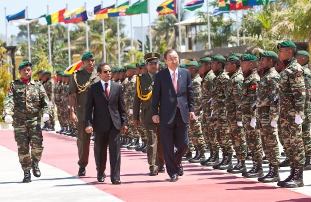 Timor-Leste President Taur Matan Ruak reviews the troops with UN Secretary-General Ban Ki-moon at th