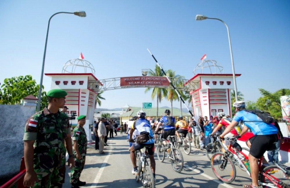 Cyclists in the 2012 Tour de Timor cross the border from Timor-Leste into Indonesia. 11 September 20