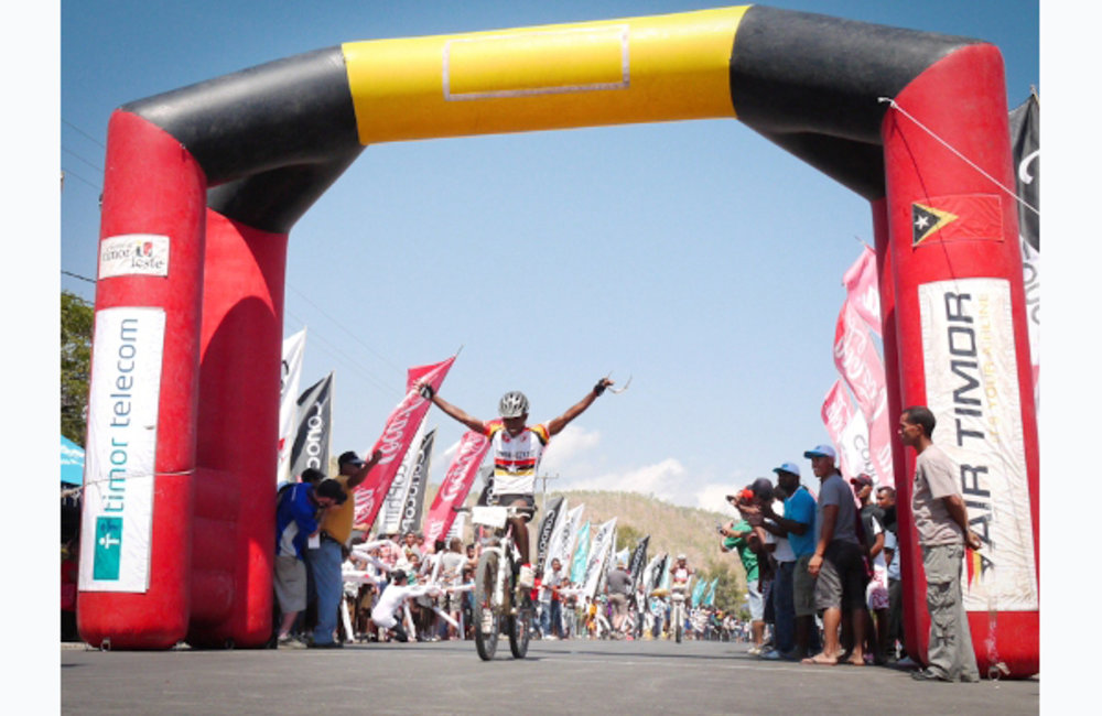 A Timorese cyclist celebrates at the finish line of the Tour de Timor. Photo by UNMIT/Sandra Black