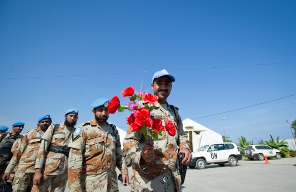 Members of the Pakistan Formed Police Unit prepare to return home. Pakistan was among the countries