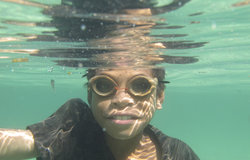 Young local diver fishes off Atauro island using traditionally made goggles and a spear gun. UNMIT/M
