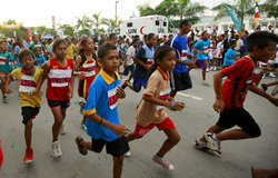 Children participating in the Run for Peace, part of the annual Dili Marathon. Photo by UNMIT/Martin