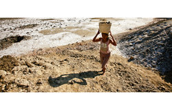 A woman harvesting sea salt at the salt pans in Ulmera, Dili. Photo Martine Perret/UNMIT